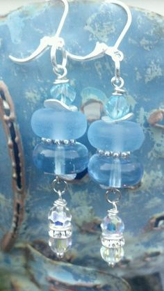 Blue glass discs, silver wavy spacers, Swarovski AB crystal rounds earrings