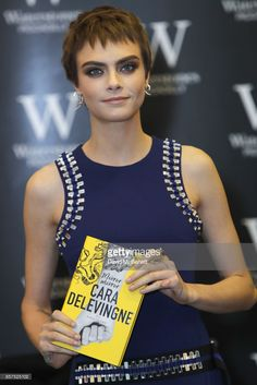 Cara Delevingne signs copies of her new book 'Mirror, Mirror' at Waterstones Piccadilly on October 4, 2017 in London, England.