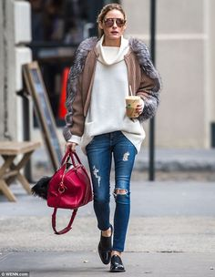 Caffeine fix: Olivia Palermo bundled up during a coffee run in New York City on Wednesday...
