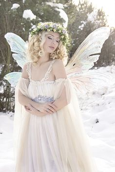 snow fairy - maybe nix the wings, but what to do if sun is shining through.  More organic feel to the snow.