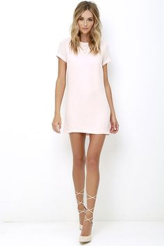 Shimmy, shuffle, and shake in the Shift and Shout Blush Pink Shift Dress, because you know you look so good! Woven poly fabric shapes a rounded neckline atop a darted bodice with short sleeves. The shift silhouette falls into a flirty, leg-baring length. Exposed gold back zipper.