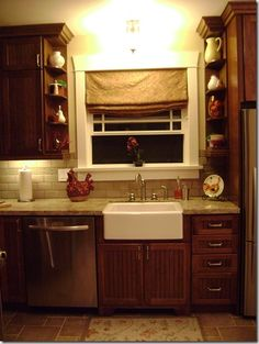 small kitchen: add shelves on sides of cabinets and squeeze in a dishwasher.