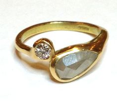 Ring in 18ct yellow gold with large rose cut grey diamond and 1/4 ct round brilliant white diamond