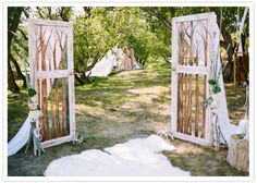 This bride painted trees on her salvage doors to go with her outdoor/fairytale themed wedding.  outdoor wedding. fairytale wedding.  wedding decor.