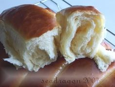 I've been using this Japanese Style Bread recipe as a basis for other bread creations.  You don't need a mixer for this, just patience with the yeast and an oven at the right temperature.