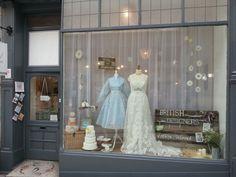 The Bridal Emporium, Leeds, England. Bridal shop specialising in 50s tea length wedding dresses, British designers and in house bridal range. Window display, window dresser, visual merchandise.