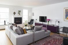 Fireplace and couch in livingroom. Interior architecture | Ramsoskar