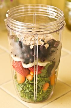 Kale, Carrots, Parsley, Strawberries, Banana, Frozen Blueberries, Flaxseeds, Oats, Add Coconut Milk & Blend.