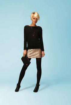 black sweater+sequined skirt