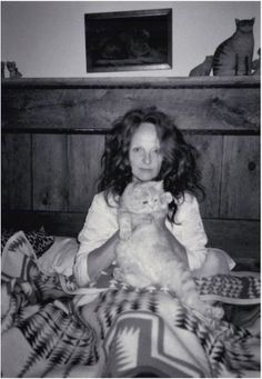 Grace with her favorite cat, Puff. Photo: Didier Malige, 2000