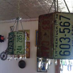 Recycle old license plates and ugly light fixtures into something you love! Drill holes and wire plates together and hang antique crystals for a little bling! -Kiki