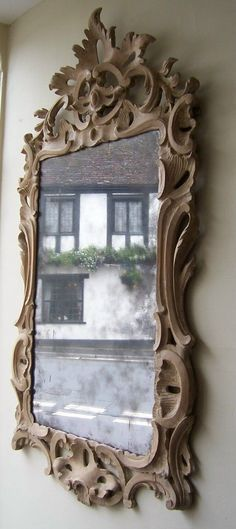 Medieval carved rococo mirror. (artist worked well on crown but seems had not enough time for the rest of the frame :) is):
