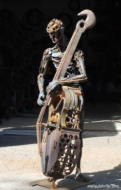 http://www.atelier-fahrner.com/art  Double bass and musician made of recycled metal.