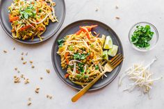 This Vegan Pad Thai is a perfect weeknight dinner! It's packed with flavor, loaded with veggies, and only takes 30 minutes to make.