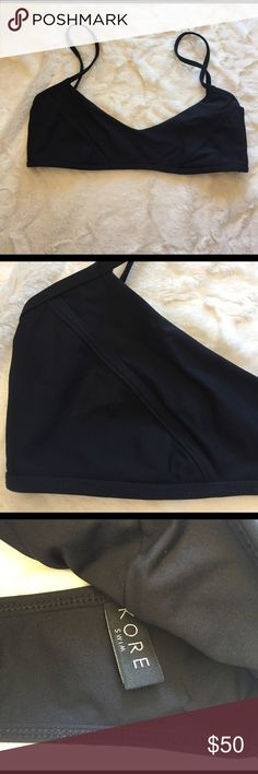 Kore Bathing Suit Top Brand new. Classic black. No padding. Stretchy. Matches easily with all black Bathing Suit bottoms kore Swim Bikinis