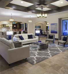 The family room or great room in Villa Sirena, an Orlando Custom Home that is a blend of Spanish Mission Architecture and Contemporary design elements by Orlando Custom Home Builder Jorge Ulibarri of Cornerstone Custom Construction