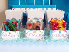 pool / beach party treats! Possibly good to use as favors. Each kid gets a box, and they fill it up with treats and pool toys as they leave.
