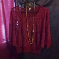 Red top with necklace Red lace top with shirt under and necklace used once size L but can fit a medium Tops Blouses