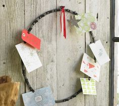 Holiday Card Wreath - Our card wreath is furnished with 28 metal clips that easily hold notes and photos, all while enlivening the surroundings. Made from recycled metal, this clever wreath acts as a changing art display year-round. Happy Holidays, Christmas Holidays, Christmas Wreaths, Christmas Cards, Christmas Ideas, Merry Christmas, Traditional Bridal Shower Gifts, Picture Wreath, Cool Cards