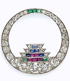 Art Deco Platinum and Diamond Gem-set Brooch, Cartier, set with old European-cut diamonds weighing approx. 0.75, 0.45, and 0.45 cts., further set with old European- and old mine-cut diamonds, and calibre-cut sapphires, rubies, and emeralds, millegrain accents, dia. 1 3/8 in., signed.