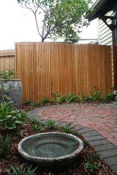 Timber batten screen covers an unsightly water tank and hot water service. Timber Battens, Timber Screens, Landscape Design Melbourne, Garden Screening, Front Fence, Water Tank, Outdoor Furniture, Outdoor Decor, Garden Design