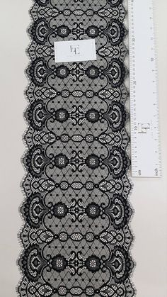 Black lace trimming. Both sides scalloped. Width: 22 cm/8.7 inches Item number: LL2255 Price is set for one meter/yard. You will receive the fabric in one continuous piece if you purchase more than 1 meter/yard. IMPORTANT! Maximum one piece length of this lace trimming is 3