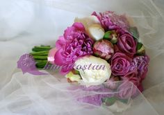 Bridal bouquet of peonies and roses.
