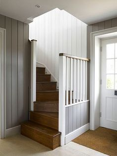Love the grey n white colors, the paneling, the curved stairway