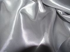 Grey Satin Silky Fabric Plain Dress And Craft Material 150cm Wide - £2.85 metre Nova Satin Silky Fabric http://www.amazon.co.uk/dp/B00M2UUVCI/ref=cm_sw_r_pi_dp_nAO4ub18RRDK5