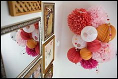 I like the idea of having a bunch of party poms and lanterns on your ceiling at all times.  This bunch is in a nursery.  So sweet for your little one to wake up to this everyday!
