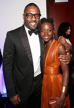 Lupita Nyong'o among the winners at NAACP Image Awards enjoys a pre-show hug from Idris Elba.