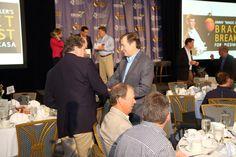 "Howard J. Barnett (dark jacket), president of Barnett Financial Group greets a guest at ""Jimmy Miller's Bracket Breakfast for Piedmont CASA"" on March 14, 2016. Image by Jennifer Byrne Photography."