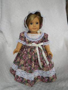 This Civil War style dress is made from a beautiful floral print fabric with roses and other flowers all over. It is trimmed with white lace at the bodice and sleeves and on the full skirt. It has a white ribbon sash at the waist. A matching lace trimmed bonnet is included in the price. Although made for American Girl dolls Addie, Marie Grace and Cecile in mind, it will fit most other 18 inch dolls with similar body style. All seams are finished and it has Velcro closings in back for ease in…