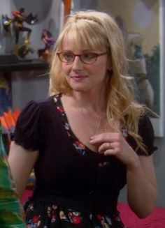 Bernadette's black cropped cardigan and floral dress on The Big Bang Theory