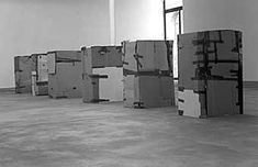 Santiago Sierra - Six People Who Are Not Allowed to be Paid for Sitting in Cardboard Boxes, 2000