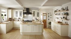 Get the shaker look in your kitchen with our Tewkesbury Framed range in Antique White. Perfectly matched with a wooden worktop to complete the look. Take a look at Howdens.