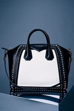 Bold and audacious. Own the moment with #Givenchy handbags.