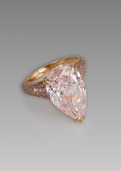 Oh my - I had no idea that I could be so captivated by a pear-shaped diamond.     David Morris pear-shaped pink diamond ring set against a glimmering backdrop of pavé pink diamonds on a rose gold band.
