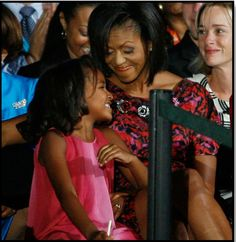 8cf61c72 Michelle (R) and Sasha Obama, 7, wife and daughter of Democratic  Presidential