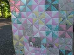 baby girl quilt scrap quilt HST blocks pinwheels pink grey turquoise yellow white elephant Mommy and baby hand quilted