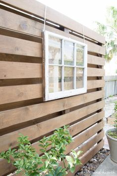 How to build a DIY privacy wall to polish off your outdoor space and provide needed privacy. Put pergola type roof on, outdoor curtains & that cute rattan outdoor couch. Perfect in the side yard! Outdoor Privacy, Backyard Privacy, Outdoor Walls, Outdoor Rooms, Outdoor Living, Outdoor Decor, Garden Privacy, Privacy Landscaping, Outdoor Couch