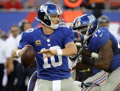 New York Giants quarterback Eli Manning (10) throws a pass during the first half of an NFL football game against the Denver Broncos Sunday, ...