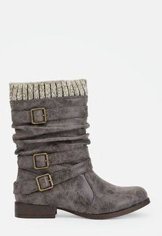 Slouchy and cool, these faux leather boots are perfect for everyday wear. They feature a sweater cuff, buckle strap detailing, and a slip-on design.  ...