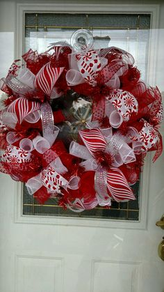 Christmas is around the corner. This Beautiful Christmas wreath would look wonderful on any door. Colors used are red and white deco mesh and
