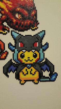 Pikachu in a Charizard X Hoodie Hama Beads Pokemon, Pokemon Craft, Perler Bead Templates, Perler Patterns, Pixel Art, Pokemon Cross Stitch, Art Perle, Pikachu, Nerd Crafts