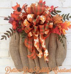 Natural Burlap Pumpkin, Burlap Pumpkin, Pumpkin, Fall Wreath, Fall Decor This is a Natural burlap pumpkin accented with fall leaves and berries, and a solid and plaid & leaf print bow arranged on a 18 grapevine wreath base, overall wreath measures approximately 18W X 23H. Great to use Autumn through Thanksgiving. In Stock