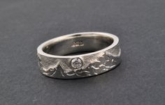 I WANT THIS ONEEE!! Except it says it's not available anymore :(   Hand Engraved Cascade Mountain Ring