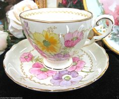 TUSCAN wedgwood teacup  BUTTER YELLOW CHINTZ-FLORAL TEA CUP AND SAUCER
