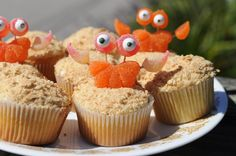 "Ridiculously cute sand crab cupcakes...Smash some graham crackers to make the ""sand"" then make the beach creatures from Orange Slice Gummies, Peach Gummies, Edible Googly Eyes"