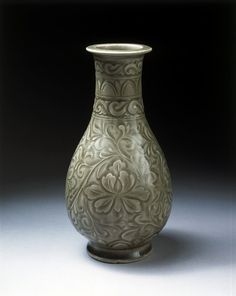 Vase, carved and glazed stoneware, Yaozhou ware, China, Northern Song dynasty, 1000-1127. Victoria & Albert Museum © V Images